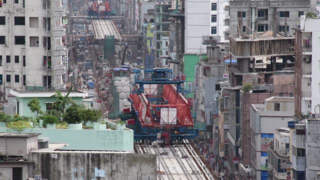 vídeos de stock e filmes b-roll de work on the dhaka mass rapid transit development project goes on in full swing in dhaka capital city in bangladesh the dhaka mass rapid transit... - rapid city