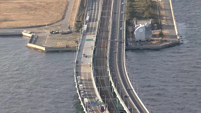 work to install two massive girders on the damaged access bridge to kansai international airport was completed before dawn on feb 14 marking a major... - bridge built structure stock videos & royalty-free footage