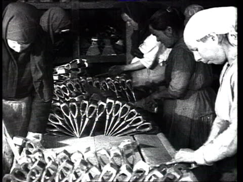 work tool's production : filing tools down, making various tools , modern machine tools/could be also late 1910s, during civil war in russia / russia - only mature women stock videos & royalty-free footage