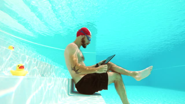 workaholic man underwater - dependency stock videos & royalty-free footage
