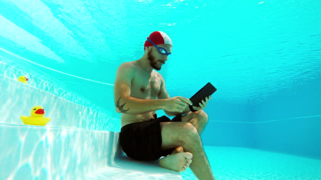 workaholic man underwater - sleep apnea stock videos and b-roll footage