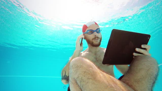 Workaholic man underwater