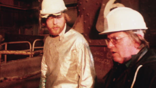 1978 montage worker and his doctor discussing health issues on the job near a furnace / united kingdom - 1978 stock videos & royalty-free footage