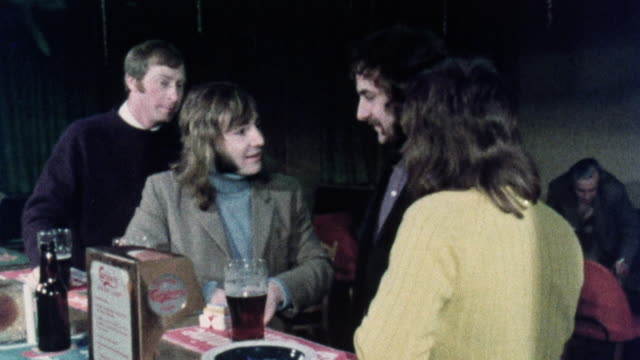 1974 montage worker arriving at club and talking to members about solid fuel / united kingdom - 1974 bildbanksvideor och videomaterial från bakom kulisserna