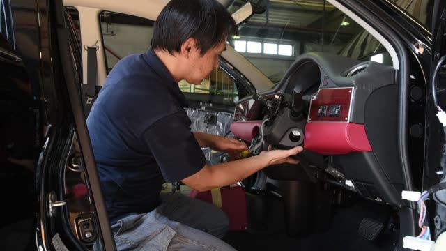 a worker assembles fittings on the dashboard of a mitsuoka motors co viewt automobile at the company's factory in toyama japan on wednesday aug 17 a... - customised stock videos & royalty-free footage
