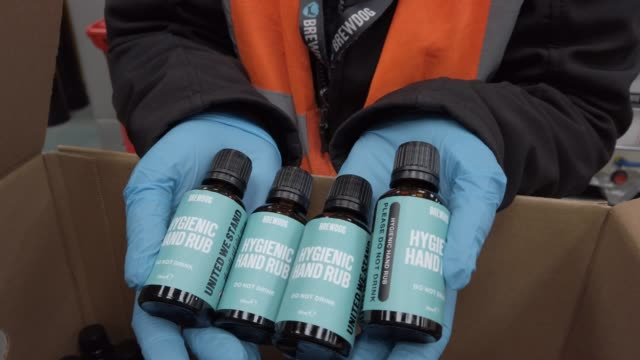 a worker at brewdog brewery shows bottles to view before packing hands sanitiser being produced at the plant during the coronavirus pandemic on april... - packing stock videos & royalty-free footage