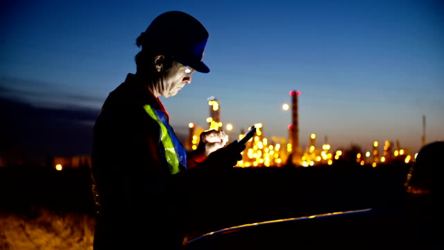 worker at industrial plant working on a tablet. - street light stock videos & royalty-free footage