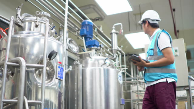 worker at industrial plant working on a tablet - fertilizer stock videos & royalty-free footage