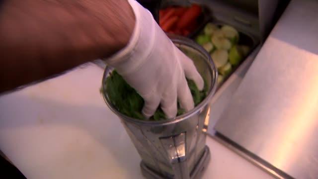 KTLA Worker at Juice Bar Making a Green Juice