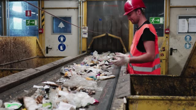 Worker at waste disposal dump