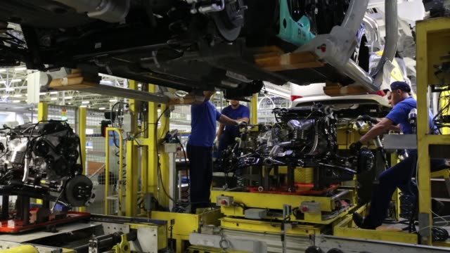 a worker attaches a hyundai badge to the trunk of a hyundai solaris vehicle on the production line at the hyundai motors corp automobile plant in st... - バッジ点の映像素材/bロール