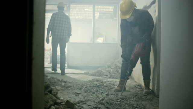 ds worker breaking up the floor in a house with a jackhammer - pneumatic drill stock videos & royalty-free footage