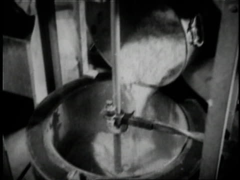 1936 B/W worker brewing beer at Anheuser Busch brewery in St. Louis / Missouri, United States