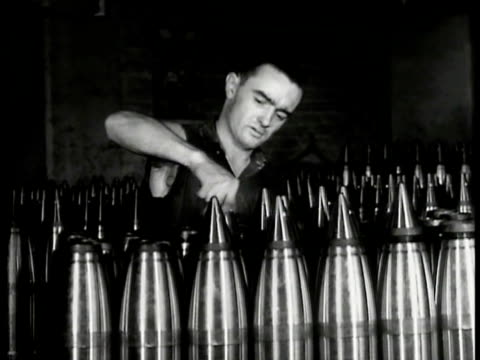 vídeos de stock, filmes e b-roll de worker capping artillery shells. line of airplane propellers being wheeled workers sanding propeller bg. ext workers exiting factory gates... - forças aliadas