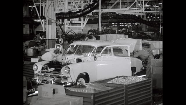 ms worker checking car on assembly line in factory / united states - 1950 stock videos & royalty-free footage