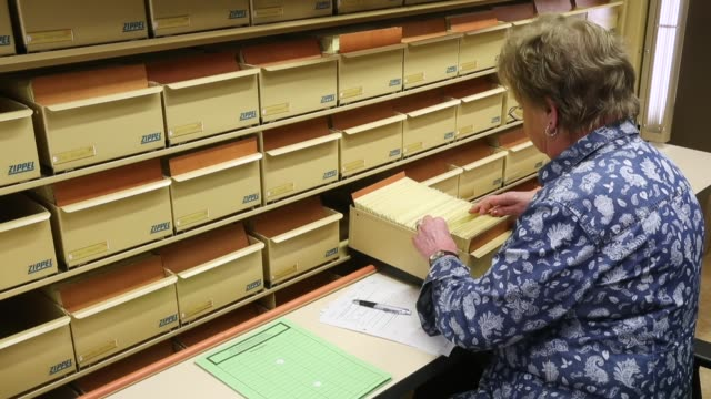 a worker checks documents in a card catalogue at the federal archive of the stasi the former east german secret police on january 13 2017 in berlin... - archives stock videos & royalty-free footage