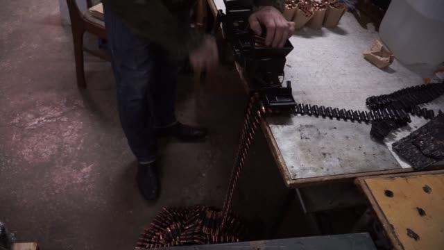 A worker checks the mechanism of a KM 7 62 machine gun at Ukroboronproms Mayak PJSC manufacturing plant in Kiev Ukraine on Wednesday March 9 A worker...