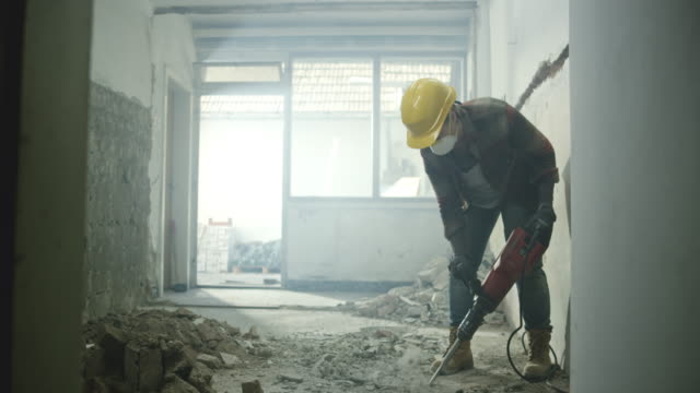 ds worker chipping away the concrete floor in a house - construction worker stock videos and b-roll footage