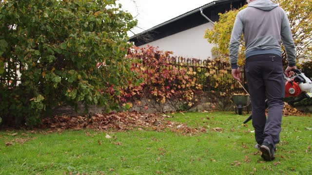 worker cleaning the garden with leaf blower - landscaped stock videos & royalty-free footage