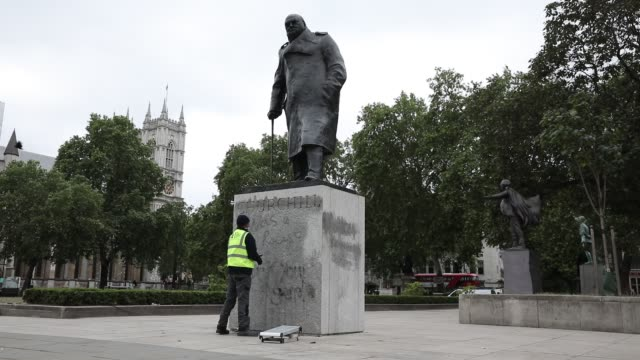 "worker cleans the churchill statue in parliament square that had been spray-painted with the words ""was a racist"" on june 08, 2020 in london,... - sculpture stock videos & royalty-free footage"