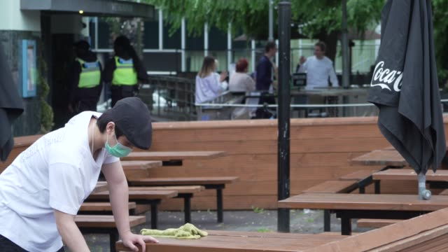 a worker cleans the tables of a restaurant on july 04 2020 in london england the uk government announced that pubs hotels and restaurants can open... - table stock videos & royalty-free footage