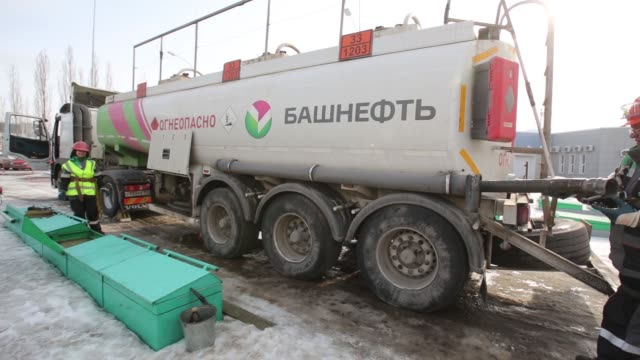 a worker connects a pipe to unload fuel from a tanker wagon at a gas station operated by bashneft pao in ufa the republic of bashkortostan russia on... - unleaded stock videos and b-roll footage