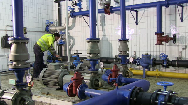 ms worker controlling wheel valve of pump station at water reservoir / konz, rhineland-palatinate, germany - water pump stock videos & royalty-free footage