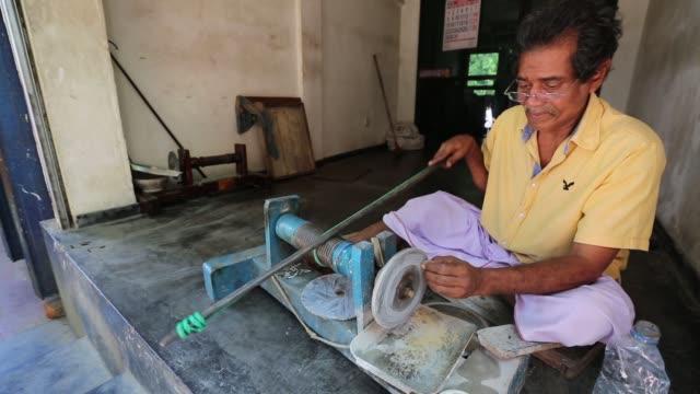 worker cuts and polishes a rough gemstone at a workshop in ratnapura, sabaragamuwa province, sri lanka, on wednesday, feb. 7, 2018. - precious gemstone stock videos & royalty-free footage
