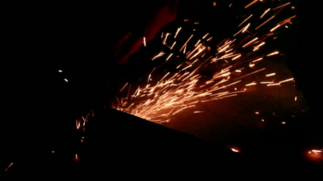 worker cutting metal girder with angle grinder - rod stock videos and b-roll footage