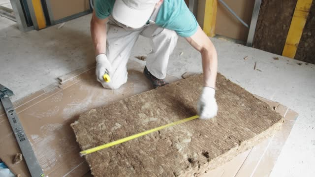 worker cutting the rock wool to size - insulator stock videos & royalty-free footage