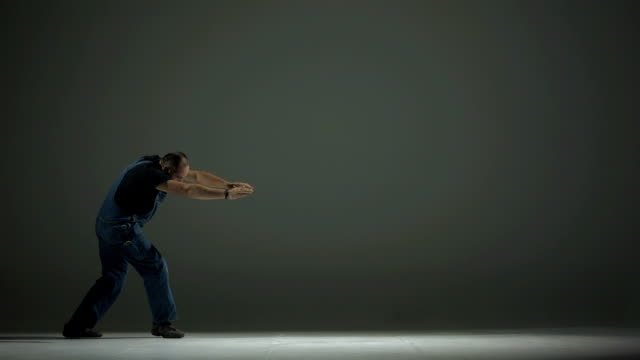 HD SLOW MOTION: Worker Doing A Cartwheel