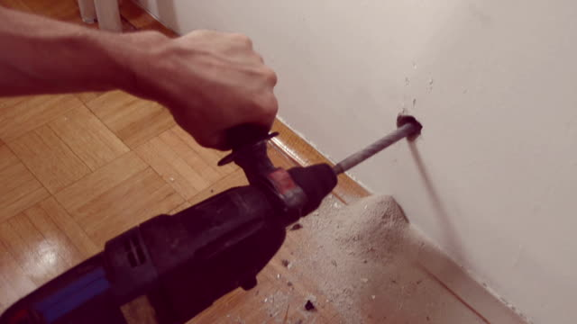 worker drilling into wall - drill stock videos & royalty-free footage