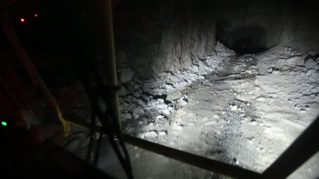 a worker drives through an underground tunnel at the taymyrsky copper mine operated by mmc norilsk nickel pjsc in norilsk russia on wednesday oct 18... - moneta da 5 centesimi statunitensi video stock e b–roll