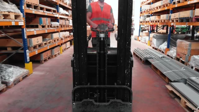 worker driving forklift in a warehouse - crate stock videos & royalty-free footage