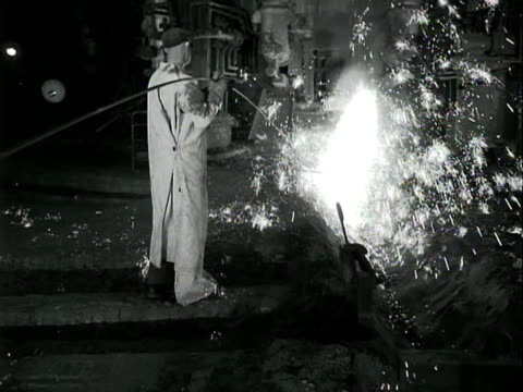 a worker feeds a strip of metal into a blast furnace at the scunthorpe steel works - metal industry stock videos & royalty-free footage