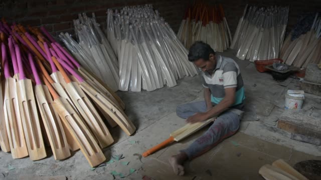 worker finishes cricket bats in a factory on june 08, 2019 in halmullah, 50 km south of srinagar, the summer capital of indian administered kashmir,... - durability stock videos & royalty-free footage