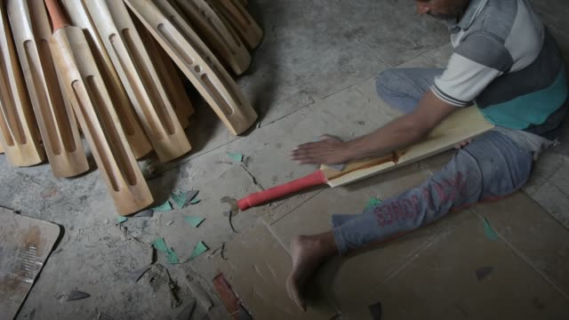 a worker finishes cricket bats in a factory on june 08 2019 in halmullah 50 km south of srinagar the summer capital of indian administered kashmir... - durability stock videos and b-roll footage