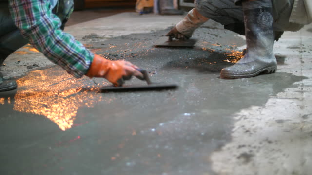 worker finishing wet concrete surface on the floor - finishing stock videos & royalty-free footage