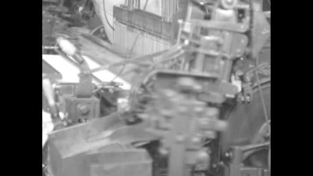 vs worker flanked by automatic shuttles on mechanized looms with a close up view of the machine / numerous women folding bolts of cloth / factory... - picket fence stock videos & royalty-free footage