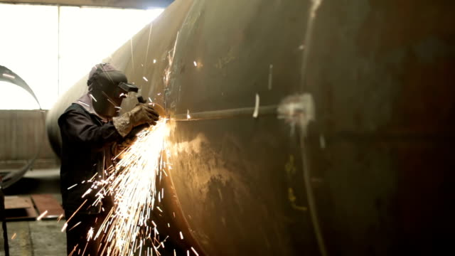 worker grinding - grinder industrial equipment stock videos & royalty-free footage