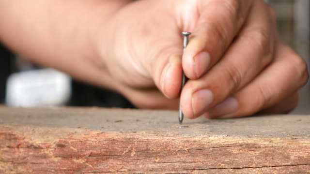 Worker hammering a nail, Close-up