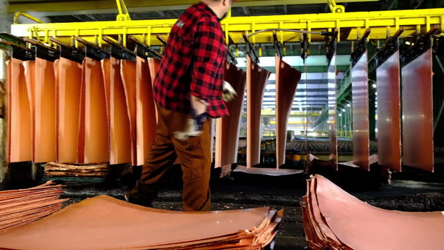 worker handles newly formed copper cathode sheets in a warehouse at the kghm polska miedz sa copper smelting plant in glogow, poland, on tuesday,... - mining stock videos & royalty-free footage