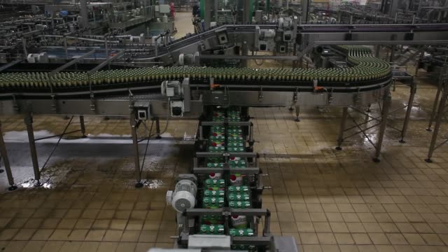 a worker holds up a bottle of beer against the light during a quality control inspection on the production line at the pilsner urquell brewery... - pilsner stock videos & royalty-free footage