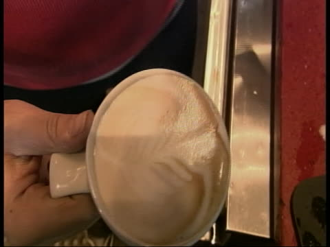 worker in a coffee shop prepares a drink. - healthcare and medicine or illness or food and drink or fitness or exercise or wellbeing stock videos & royalty-free footage