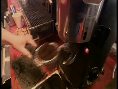 worker in a coffee shop prepares a drink. - coffee drink stock videos & royalty-free footage