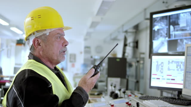 PAN worker in control center communicating over handheld receiver