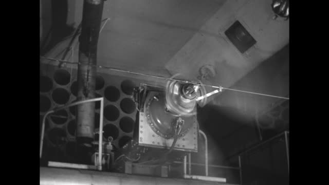 worker in factory tests airplane propeller by operating motor that makes it spin / propeller spinning / worker putting artillery shells into... - artiglieria video stock e b–roll