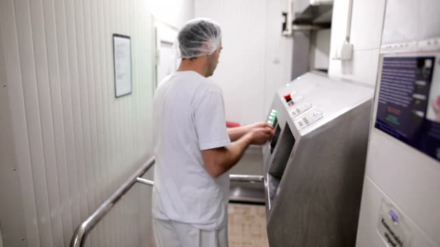 worker in sterile cloths washing hands before working.hand hygiene at food factory - dustman stock videos & royalty-free footage