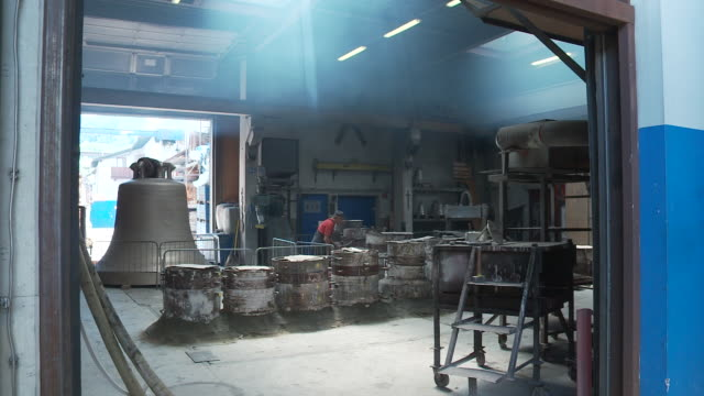 worker in the bell foundry - foundry worker stock videos and b-roll footage