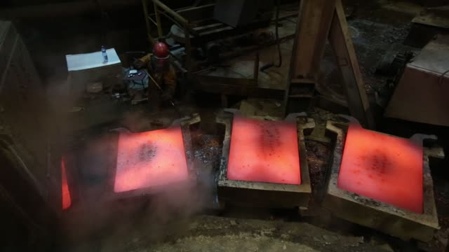 a worker inspects a newlycast copper anode sheet as it cools in its mold at the mmc norilsk nickel pjsc copper refinery in norilsk russia on thursday... - five cent coin stock videos & royalty-free footage